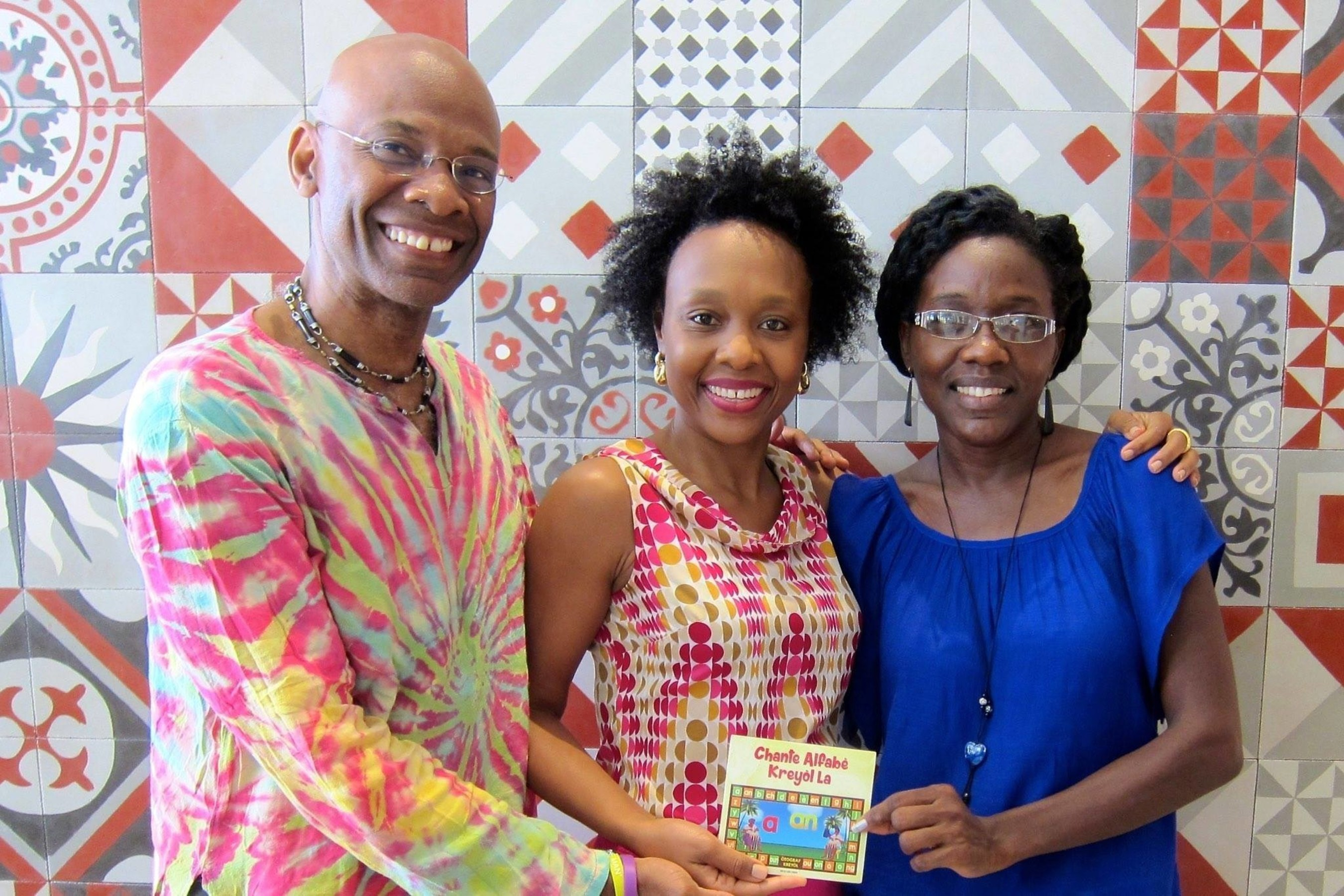 Professor Michel DeGraff, Marie Rodny Laurent and Ann Timothee Milfort Holding the newly released DVD of the kreyol alphabet