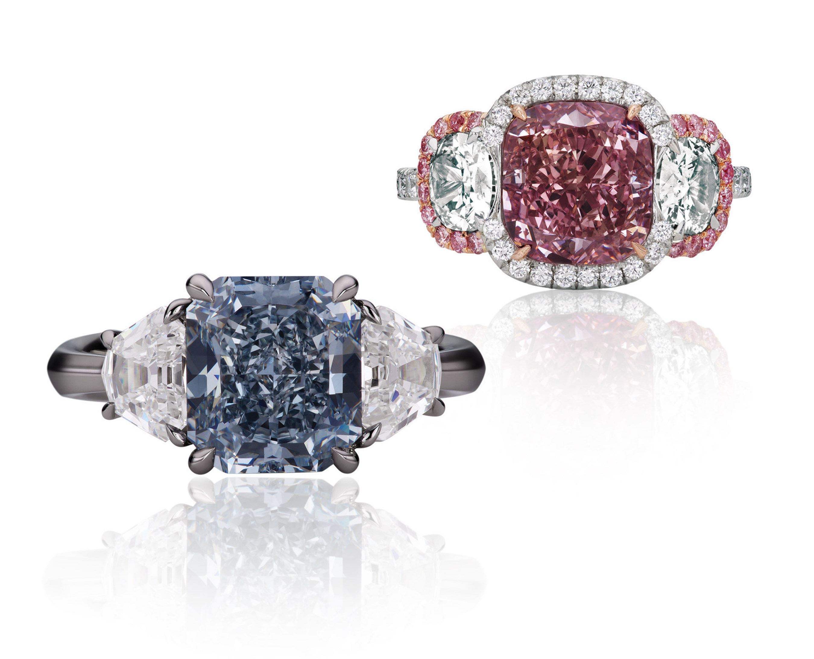 Radiant-Cut Fancy Intense Blue Diamond Ring: Internally Flawless Fancy Intense Blue Diamond, 3 Carats, Set in Platinum with 2 White Diamonds.   Cushion-Cut Fancy Intense Purple-Pink Diamond Ring: Rare Fancy Intense Purple-Pink Diamond, 3 Carats, SI1, Set in Platinum and 18K Rose Gold with 2 White Diamonds, and Surrounded by Argyle Pink Diamonds and White Diamonds. GIA Certified. Prices on request.