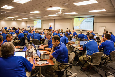 Claim personnel turn conference room into command center to prep for approaching storm