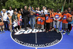 WorldVentures CEO Dan Stammen cuts ribbon at Greenburgh, N.Y. DreamCourt dedication accompanied by WorldVentures Marketing Director and lead fundraiser James Robinson, Greenburgh town officials, and members of the community.