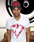 "Enrique Iglesias sporting his new ""heart"" T-shirt.  All net proceeds from sales of the T-shirt will go to help kids in times of crises.  Photo by Al Silfen"