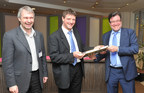Geert Heyninck (L), General Manager of Alcatel-Lucent's Broadband Access business, presents a golden line card representing 10 million VDSL2 vectoring shipments to Patrick Delcoigne (C), Head of Fixed Access Networks, and Johan Luystermans (R), Director Network, Engineering & Operations at Proximus.