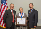 NASA's Charles Elachi, Director, Jet Propulsion Laboratory and John Grunsfeld, NASA's Associate Administrator for Science Mission Directorate congratulate Ball Aerospace's Marda Barthuli on her NASA Exceptional Public Service Medal for work on the CloudSat mission. (PRNewsFoto/Ball Aerospace & Technologies...)