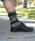 The Out of Sight Case straps on to one's leg.  (PRNewsFoto/Out of Sight Cases)