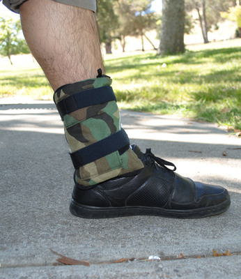 The Out of Sight Case straps on to one's leg. (PRNewsFoto/Out of Sight Cases) (PRNewsFoto/OUT OF SIGHT CASES)