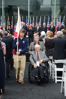 """Luke Jackson, the Alabama """"Salute to Freedom Winner"""" accompanies a WWII veteran at the opening of the WWII Museum's new US Freedom Pavilion: The Boeing Center."""