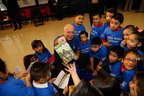 Manolo Sanchez, president and CEO of BBVA Compass, read to students at this morning's NBA Cares Team. Works. In Schools event at Benjamin Franklin Elementary in Houston, Texas. (PRNewsFoto/BBVA Compass) (PRNewsFoto/BBVA COMPASS)