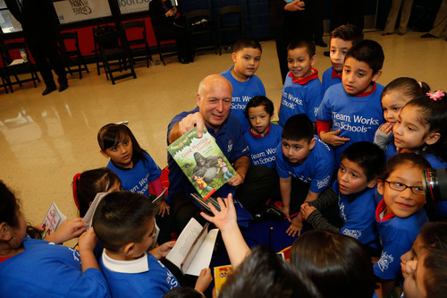 Manolo Sanchez, president and CEO of BBVA Compass, read to students at this morning's NBA Cares Team. ...
