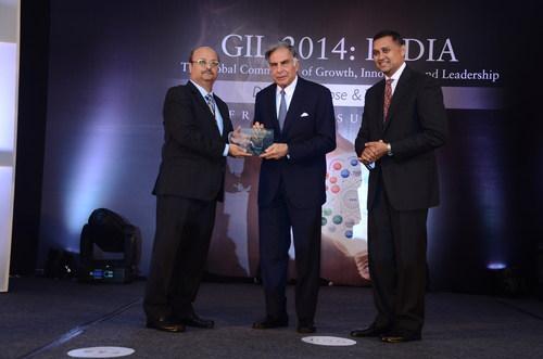 Chairman Emeritus, Tata Sons, Mr. Ratan Tata receives the Frost & Sullivan Growth, Innovation and Leadership Award for Visionary Innovation from Mr. Aroop Zutshi, Global President & Managing Partner (L) and  Mr. Rajiv Kumar, Senior Partner & Global Vice President (PRNewsFoto/Frost & Sullivan)