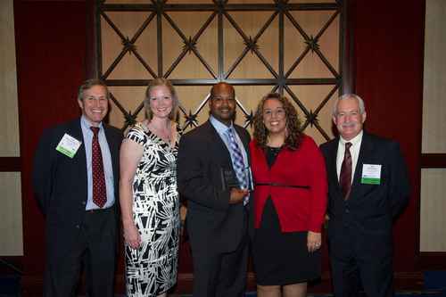 Coverall was recently named a Top 50 Franchise for Minorities by NMFI. Pictured are Coverall Chief Legal Officer Les Wharton; Louisville Master Director of Sales, Alanna Cochran; 2013 Franchise Owners of the Year Damion and Maria Jones and CEO Rick Ascolese.  (PRNewsFoto/Coverall)