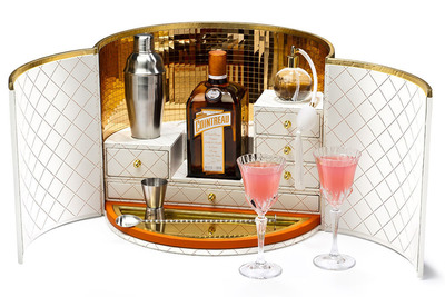 """Together with Cointreau, the original French triple sec, Dita Von Teese launches """"My Cointreau Travel Essentials"""" in the United States. Presented in a chic, retro hatbox, the luxury coffret opens up to reveal a beautiful travel bar that conveniently contains all the accessories needed to create original cocktails while jet setting around the globe or while celebrating at home with friends. The white and grained-leather finished mini bar is equipped with a jigger for measuring; a special bar spoon; two vintage-inspired glasses; a silver shaker; a Cointreau atomizer, a leather-bound Cointreau cocktail notebook and signed, limited-edition bottle of Cointreau. (PRNewsFoto/Morgans Hotel Group Co., Pascal Bouclier)"""