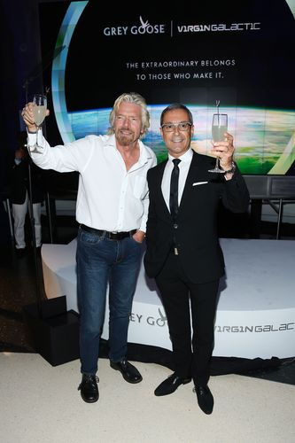 GREY GOOSEÂ(R) creator and Maitre de Chai Francois Thibault and Virgin Galactic founder Sir Richard Branson celebrate their new pioneering partnership at the Rose Centre for Earth and Space (PRNewsFoto/GREY GOOSE)