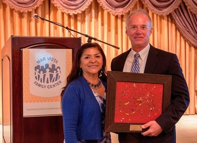 Sodexo Receives Corporate Champion Award from Mar Vista Family Center. Lucia Diaz, Chief Executive Officer of The Mar Vista Family Center presents the Corporate Champion Award to Kirt Ingram of Sodexo.