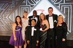 Founders of A Night to Remember Prom accept the S. Truett Cathy Award and pose with Chick-fil-A Foundation Executive Director Rodney Bullard.