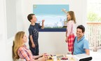 A family playing games and collaborating with the Touchjet Pond Projector on their kitchen wall.