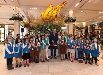 Girl Scouts of Greater New York join Mike Gansmoe, executive producer of Macy's Flower Show, in the official ribbon cutting ceremony for the grand opening of the 42nd Annual Macy's Flower Show.  Photo credit Diane Bondareff / AP Images for Macy's Inc.