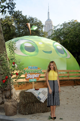 Ashley Tisdale, actress, producer and entrepreneur celebrates the launch of King's Farm Heroes Super Saga mobile game in the iconic Madison Square Park with the first Interactive Urban Orchard on Tuesday, Sept. 21, 2016 in New York.