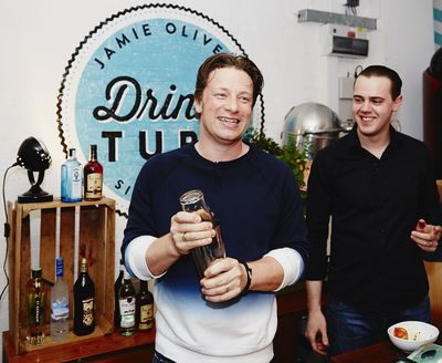 Jamie Oliver and Simone Caporale, bartender at the world's #1 cocktail bar, The Artesian, toast the launch of the new content partnership between Bacardi and The Jamie Oliver Group. Bacardi is the founding partner of Jamie's new YouTube channel called Drinks Tube.