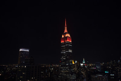 The Empire State Building Glowing Red and Gold