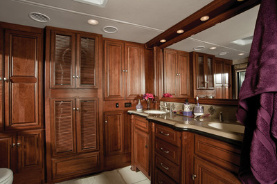 The luxurious master bathroom in the well appointed 2012 Itasca Ellipse 42JD by Winnebago Industries, Inc.  The new 42JD features a half bath mid-coach, an open lounge/kitchen area, two TVs and a king bed.  (PRNewsFoto/Winnebago Industries, Inc.)