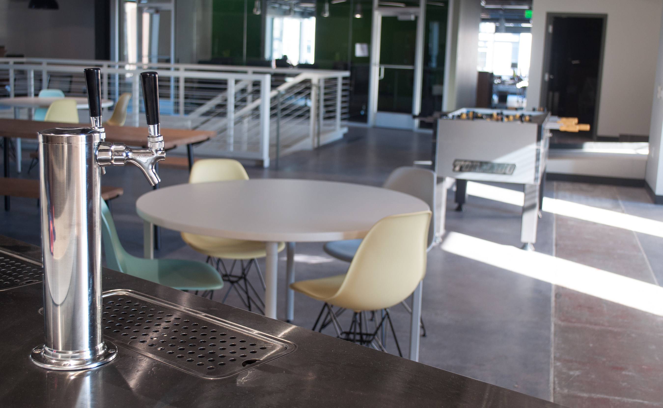 EatStreet's game room is complete with shuffleboard and ping-pong table, a kitchen, three beer taps and a 30-foot bar.