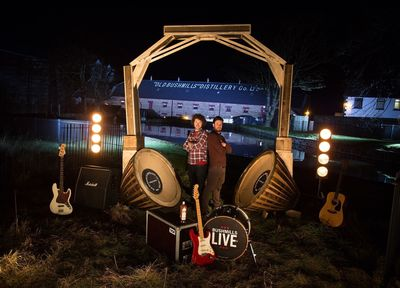 The world's largest barrel oak headphones handcrafted by two local artisans, Matt Minford and Gareth Martin, pictured, to celebrate the launch of 'Bushmills Live 2014.' Made using almost a dozen giant whiskey barrels, the headphones stand at over 10ft high and will form an interactive centrepiece with music from Bushmills Live artists past and present. Festival-goers will be able to sit between the ear pieces to share a truly unique combination of handcrafted whiskey and music. Whiskey and music fans can win the chance to attend the festival, headlined by The 1975 and held on 11th and 12th June, by entering a draw at www.facebook.com/bushmills. Entries open on Monday, March 17 (St Patrick's Day) at 16:08 GMT.