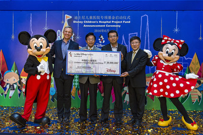 L-R: Mickey Mouse, Chairman and CEO of The Walt Disney Company Bob Iger, Shanghai Charity Foundation Vice Chairperson Song Yi Qiao, China Soong Ching Ling Foundation Vice Chairman Jing Dunquan, Shanghai Children's Medical Center Director Jiang Zhongyi, Minnie Mouse