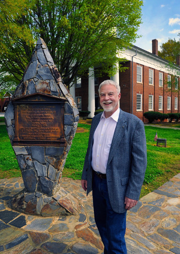 Town of Hillsborough, North Carolina Mayor Tom Stevens stands in downtown Hillsborough at an historic marker at  ...