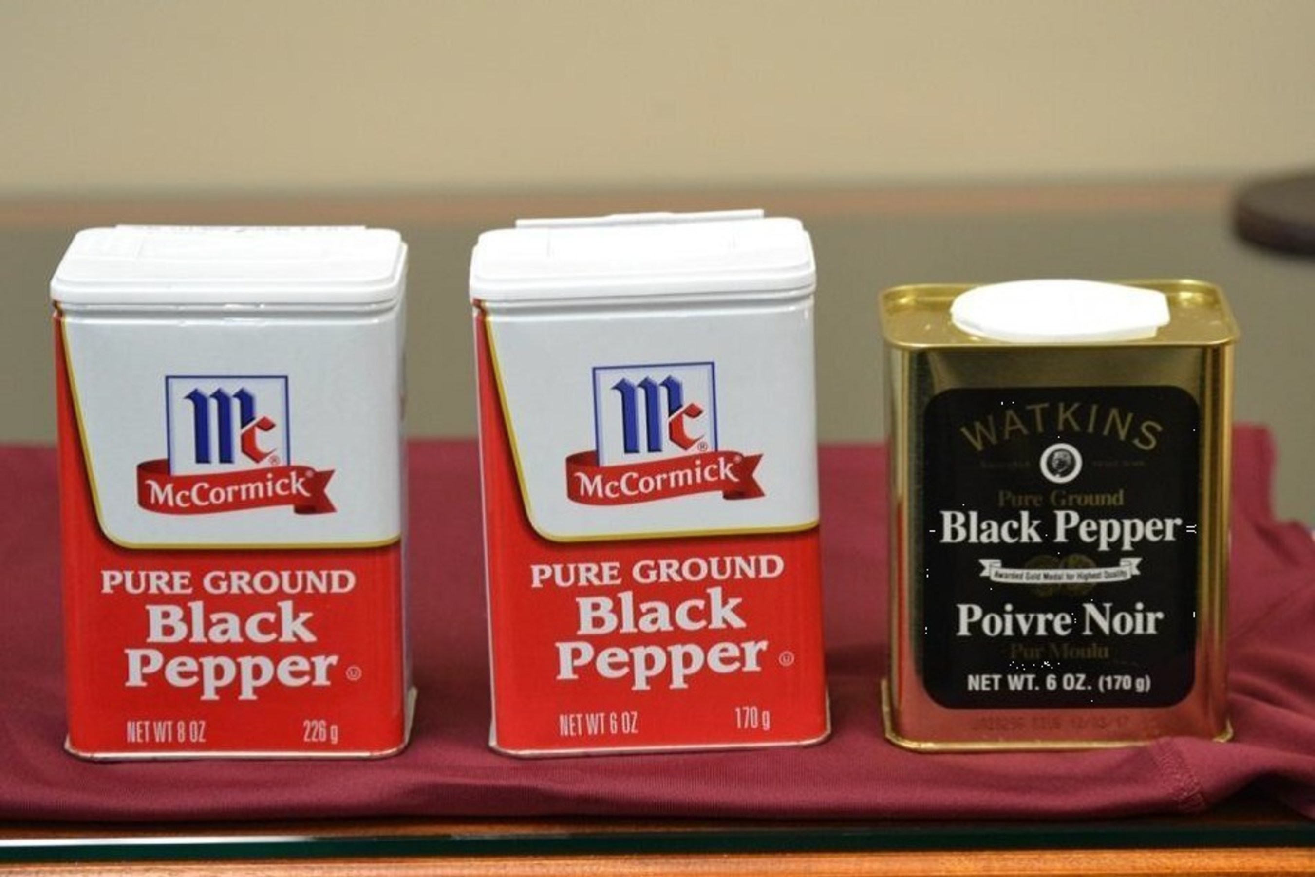 The McCormick Large Tins with an 8-ounce fill (on the left) was marketed for decades. McCormick's use of the same McCormick Large Tin with a 6-ounce fill with nonfunctional slack-fill (in the middle) gives the false and misleading impression that there is more ground pepper in the tin than in the Watkins Tin (on the right) which also has six ounces of ground black pepper.