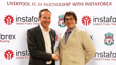 Liverpool FC, Commercial Director Olly Dale and InstaForex VP Dmitry Savchenko sign the two year partnership extension. (PRNewsFoto/InstaForex and Liverpool FC)