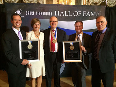 The IMRIS neuroArm/SYMBIS surgical robotics program was inducted into the Space Technology Hall of Fame. Accepting the Space Foundation honor were representatives involved in the project (L-R): Jay Miller, Amy Boyle, IMRIS; Dr. Garnette Sutherland, University of Calgary; D. Craig Thornton, MacDonald, Dettwiler and Associates Ltd.; and Meir Dahan, IMRIS. (PRNewsFoto/IMRIS Inc.)