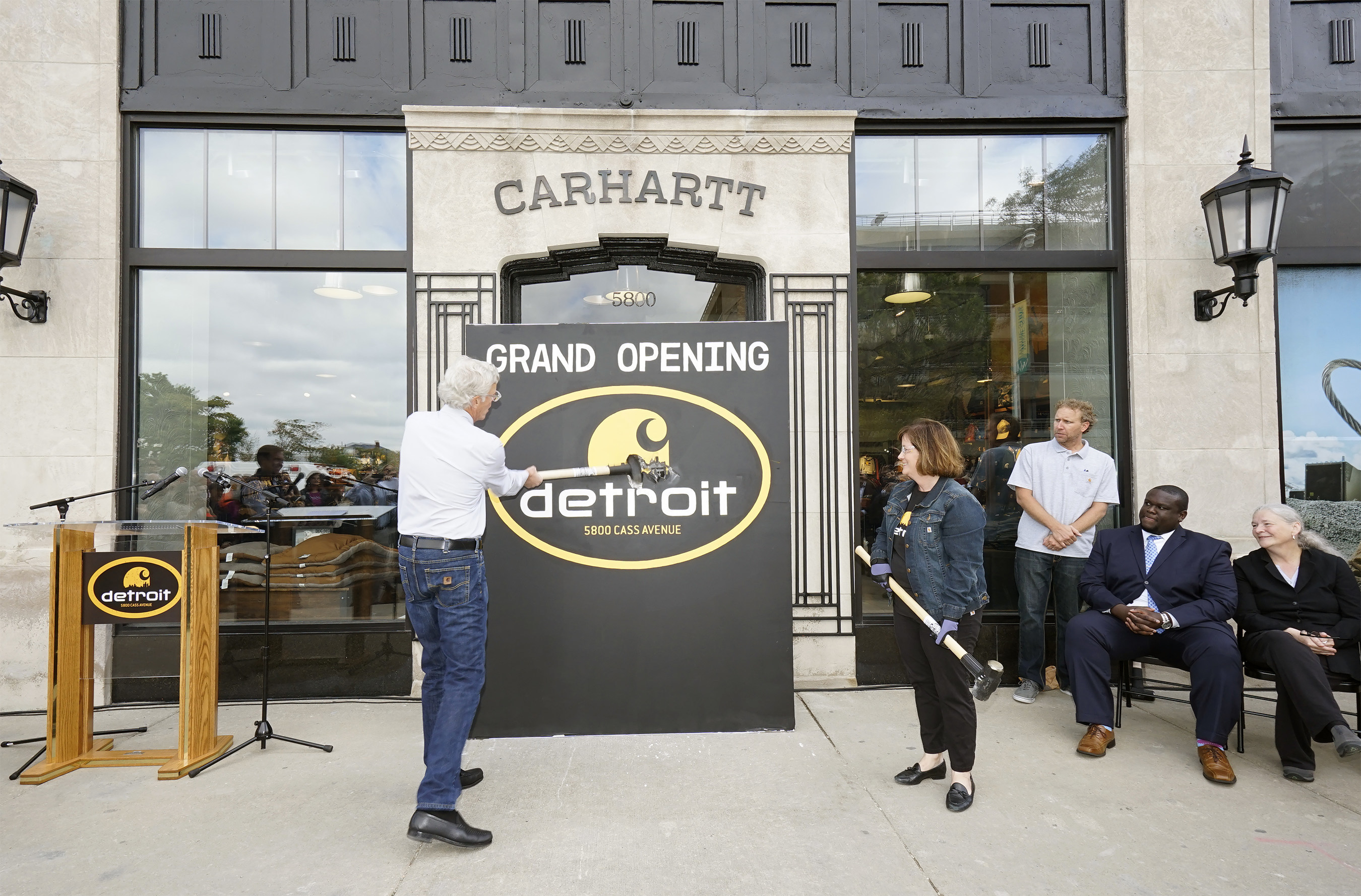 Carhartt CEO and Chairman of the Board, Mark Valade and Carhartt President and COO, Linda Hubbard prepare to open Carhartt's new flagship store in Midtown Detroit in Carhartt style by busting through a wall in lieu of a traditional ribbon-cutting ceremony.