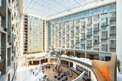 "The interior of the Washington, D.C., Marriott Marquis features a football field-sized skylight and a five-story sculpture named ""The Birth of the American Flag,"" which was created by Baltimore-based artist Rodney Carroll. (Photo by Josh Meister) (PRNewsFoto/tvsdesign and Cooper Carry)"