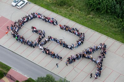 The news of G2A's new award was announced at the annual summer party for their 600 staff. Picture shows the staff making up the logo and filmed from a helicopter. (PRNewsFoto/G2A.com)