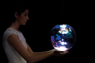 "2014 Lexus Design Award prototype winner ""Iris"" by designer Sebastian Scherer is a hand blown crystal sphere glass lamp that shimmers in different colors from every angle. (PRNewsFoto/Lexus)"
