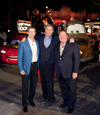 "(L-R): Tom Staggs, Chairman of Walt Disney Parks and Resorts, Robert A. Iger, Chairman and CEO of The Walt Disney Co. and John Lasseter, Chief Creative Officer of Walt Disney and Pixar Animation Studio, and Principal Creative Advisor for Walt Disney Imagineering, pose June 13, 2012 following the gala opening of Cars Land at Disney California Adventure park at Disneyland Resort in Anaheim, Calif. Cars Land features three immersive family attractions showcasing characters and settings from the Disney-Pixar film, ""Cars.""  (PRNewsFoto/Disneyland Resort)"