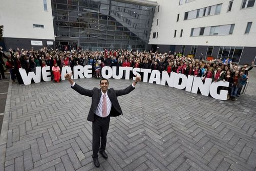 Image shows Jatinder Sharma, Principal and Chief Executive at Walsall College (front) celebrating with staff, students and governors at the college. (PRNewsFoto/Walsall College)