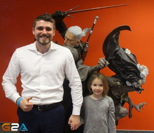 Co-founder/CMO of G2A, Dawid Rozek shows his tender side posing with Gabrysia Skalska who represents the many children who have been helped by the auction of the Witcher statue that now lives at G2A offices in Rzeszow, Poland. (PRNewsFoto/G2A.com) (PRNewsFoto/G2A.com)