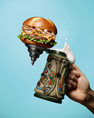 This season, Red Robin fans will raise their steins in approval with the return of a fall favorite -- the Oktoberfest Burger!  Now through Nov. 10, guests can enjoy the craveable Oktoberfest Burger, a fire-grilled burger topped with Black Forest ham, Swiss cheese, tangy beer-mustard sauteed onions and crisp lettuce on a perfectly toasted pretzel bun.  (PRNewsFoto/Red Robin Gourmet Burgers, Inc.)