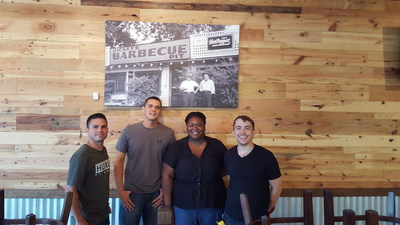Owner/Operator Brannan Stine (far right) stands next to his team inside of the new Dickey's at Lake Nona.