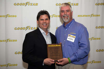 2012 Goodyear North America Highway Hero Award winner Jason Harte (right), with Gary Medalis, director of marketing, Goodyear Commercial Tire Systems. Harte, rescued a family of six from a smashed minivan, has been named the 30th Goodyear Highway Hero.  (PRNewsFoto/The Goodyear Tire & Rubber Company)