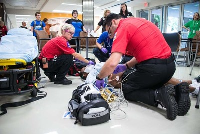 Partnering with Houston Methodist Willowbrook Hospital, Cypress Creek EMS volunteers respond to a code AMI (acute myocardial infarction) as part of a drill held at the D. Bradley McWilliams YMCA, organized to provide life saving community education regarding early heart attack care.