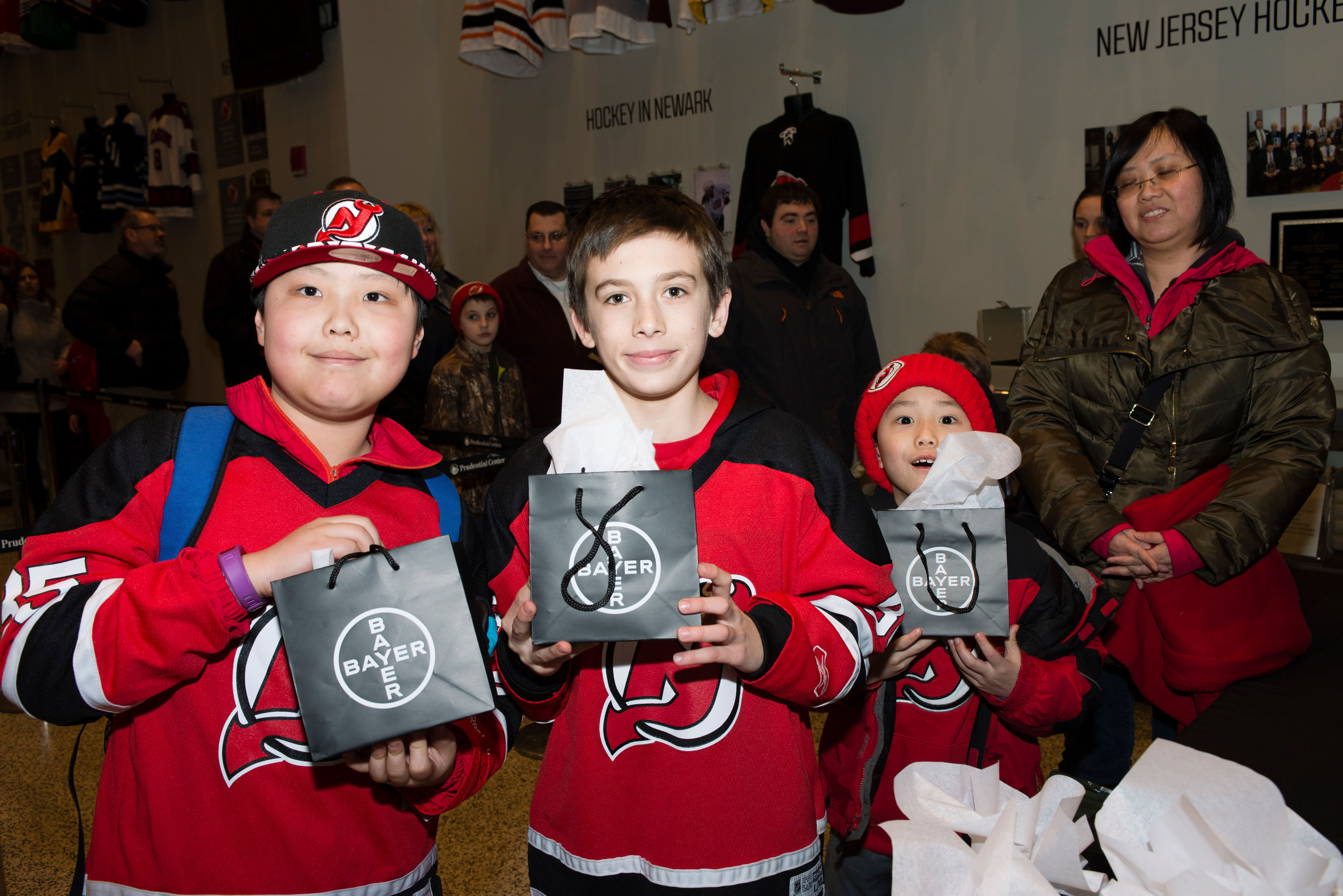 Young Devils fans receive souvenirs at Bayer Fights Cancer Night on Feb. 6, 2015.