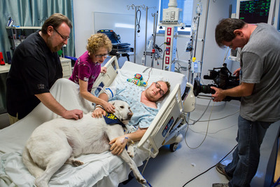 "Finn, a former shelter dog, bringing comfort to Jacob Chodash, who had a brain tumor removed at Ronald Reagan UCLA Medical Center. These once-forgotten pets are now helping patients heal and bringing joy to families, doctors and nurses. Volunteers who bring their shelter dogs to a hospital is just one of the amazing stories told in the PBS episode, ""Shelter Me: Let's Go Home,"" which is airing on stations across the country. Shelter Me is an inspiring PBS series that celebrates shelter pets with positive and uplifting stories. Find us on Facebook: https://www.facebook.com/ShelterMeTV.  (PRNewsFoto/ShelterMe.tv)"
