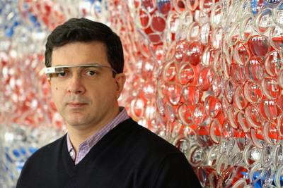 Artist David Datuna with Portrait of America and Google Glass at his Brooklyn, NY studio.  (PRNewsFoto/KIWI Arts Group)