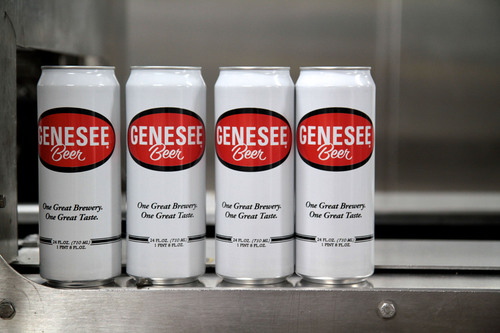 24-ounce cans of Genesee beer roll off the new $3.5 million production line at The Genesee Brewery. ...