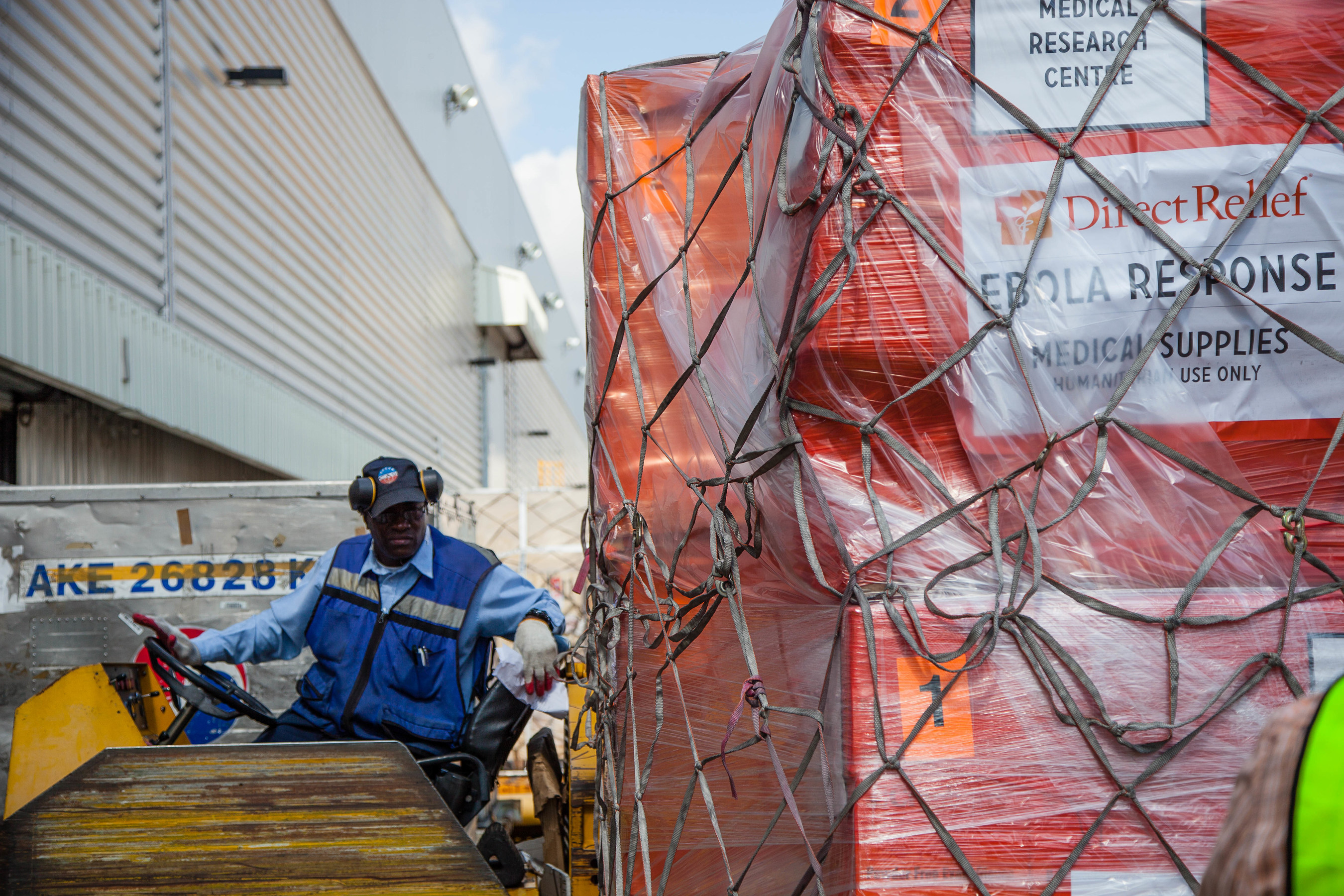 Offloading Ebola relief supplies from Direct Relief to aid in response efforts.