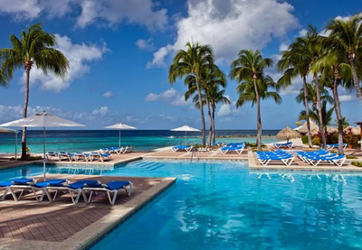Forget the cold weather. Spend Christmas by the pool at the Curacao Marriott Beach Resort & Emerald Casino. The Curacao all-inclusive resort's Sand Dollars Package allows visitors to stay for three nights in deluxe accommodations with rates from $239 to $429, then get a fourth night free. Guests also earn a $50 resort credit daily that can be used for in-room movies or at the Curacao resort's restaurants and spa. For information, visit www.marriott.com/CURMC or call 599-9-736-8800.  (PRNewsFoto/Curacao Marriott Beach Resort & Emerald Casino)