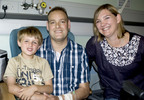 Matthew Green, the first SynCardia Total Artificial Heart patient in the UK to be discharged from the hospital using the Freedom(r) portable driver, with his wife Gill and his 5-year-old son Dylan.  (PRNewsFoto/SynCardia Systems, Inc.)