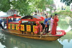Zhouzhuang water town weddings begin with the groom escorting the bride by rowing a fast boat to the dock